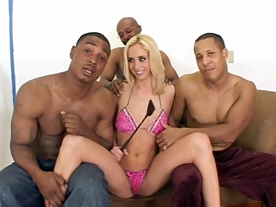 Another smoking hot interracial clip featuring Kelly Wells but this time things got rough for her as three guys ganged up on her. It starts with this lovely blonde model sitting next to three guys and showing off her natural boobs and tiny pink cooter.